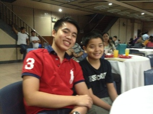 With the youngest member of the team during the closing dinner.....so much potential for this kid! :D